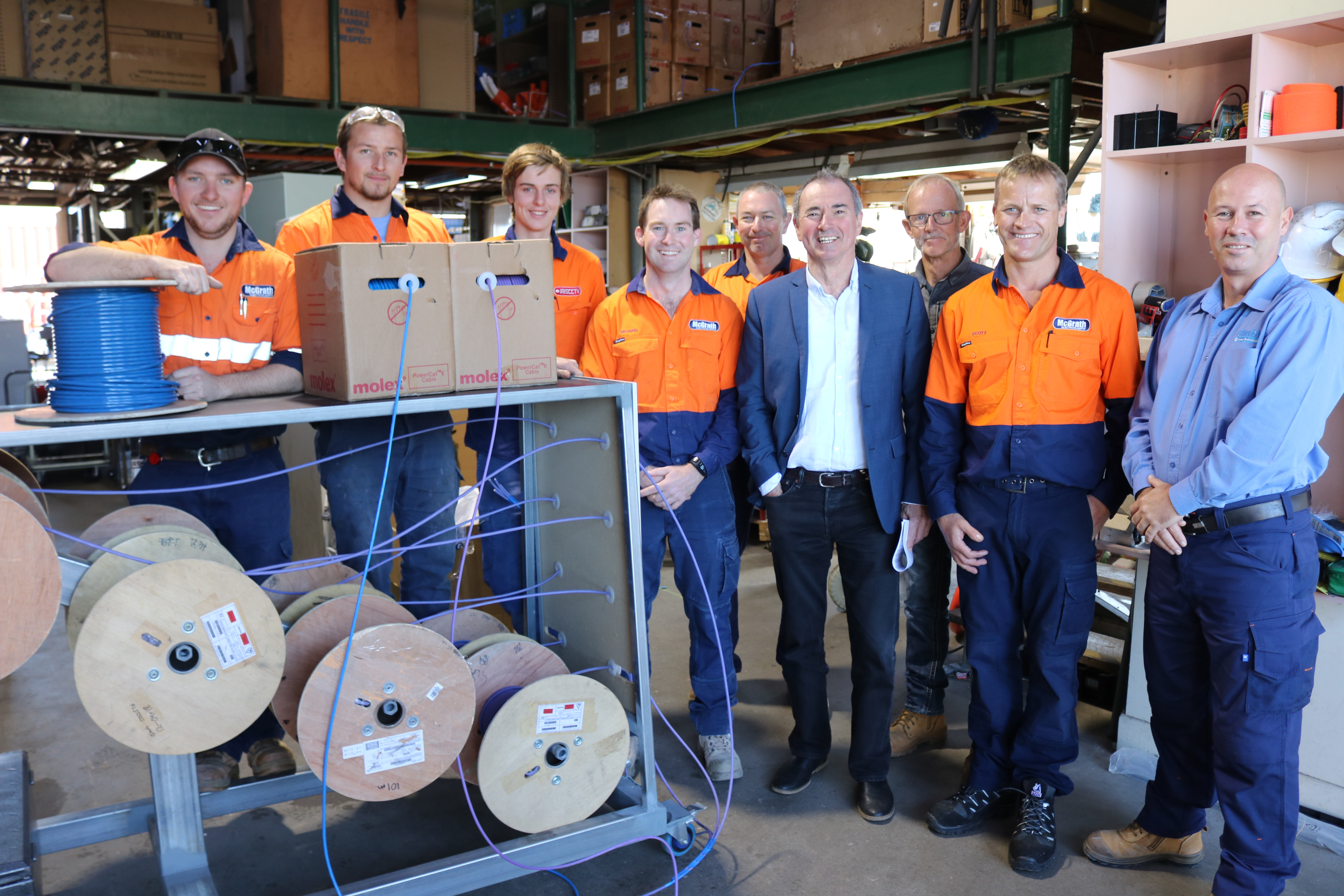 PHOTO: Mr Gulaptis is pictured with McGrath Electrical & Data employees and representatives from Saab Australia and Chubb Fire & Security
