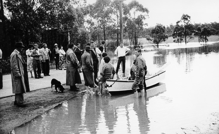 People gathered by floodwater at Windsor (November 1961) - Photo courtesy Barry Gibbs collection Hawkesbury City Council Library Service